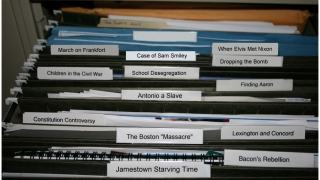 The site's file drawer displays cases slated for investigation.