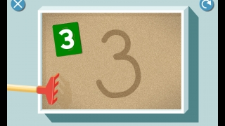 Activities based on Montessori materials, such as sandpaper numbers and sand tray for tracing.
