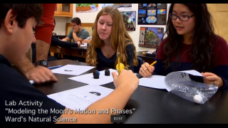A professional development video shows a hands-on activity in action.