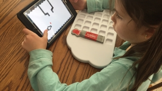 Kids manipulate actual paint Puzzlet tiles and then watch what happens on their hand-held devices.