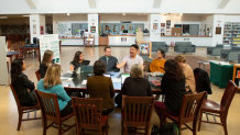 Photo of teachers meeting in a library