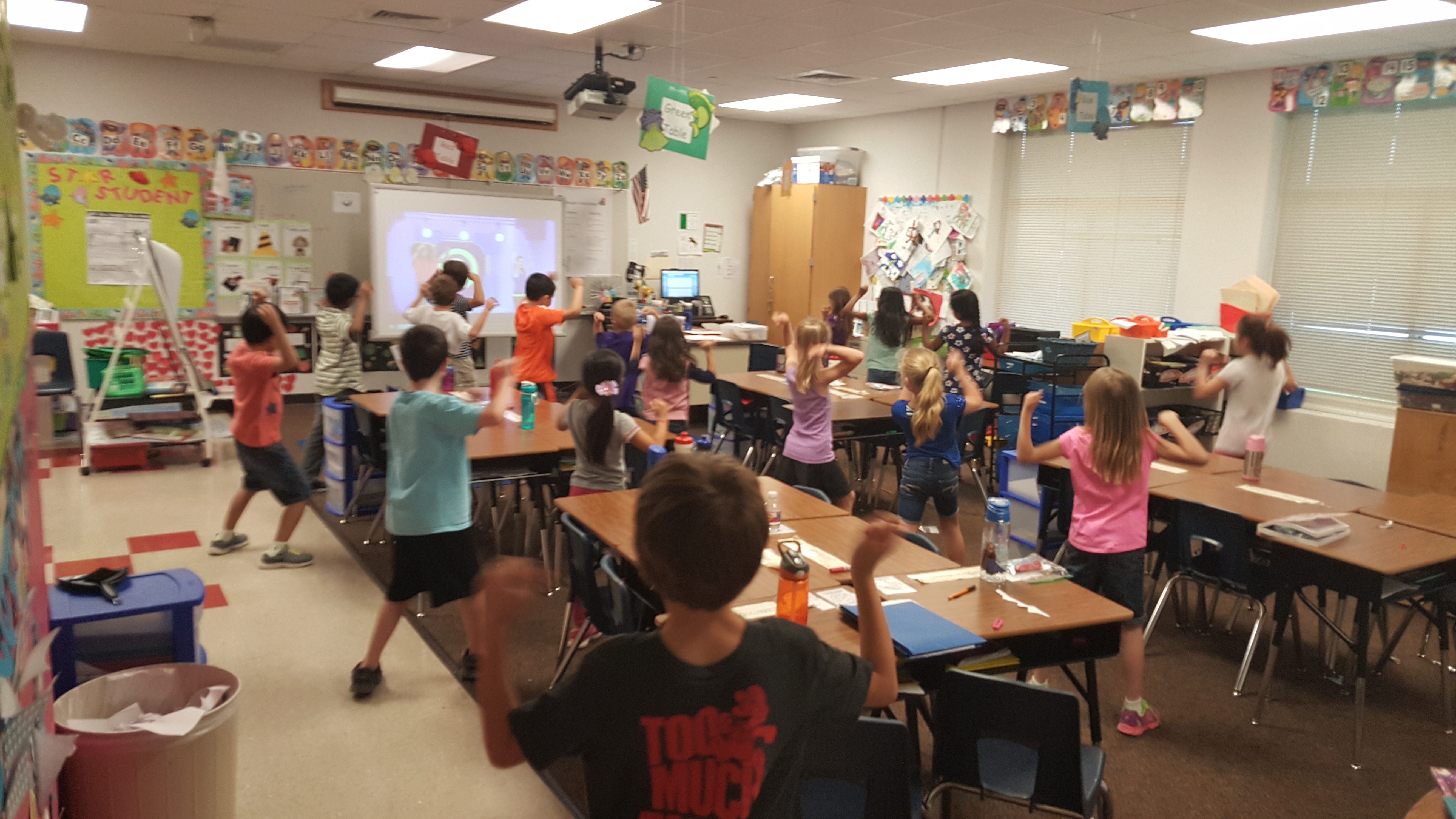 kids exercising with GoNoodle in the classroom