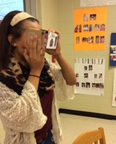 girl taking picture in makerspace