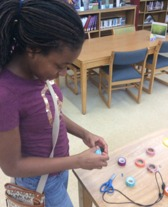 girl using makerspace
